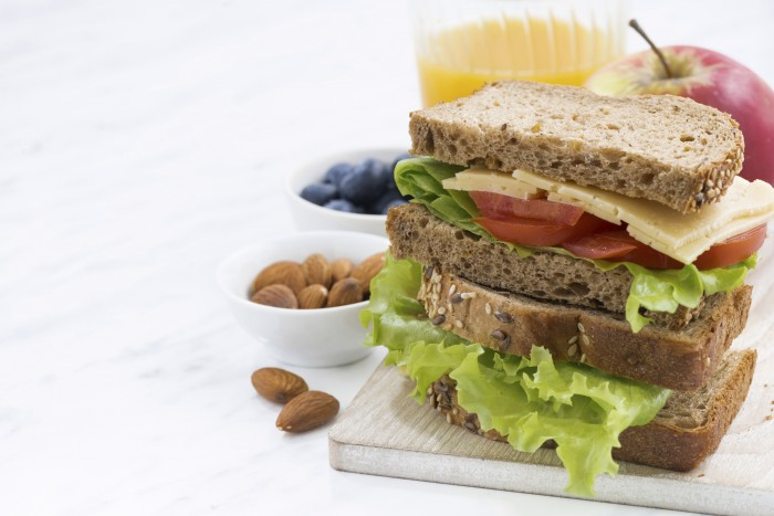 school lunch with sandwich of wholemeal bread, closeup