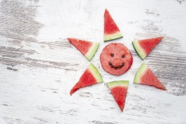 slices of watermelon arranged in the shape of the sun
