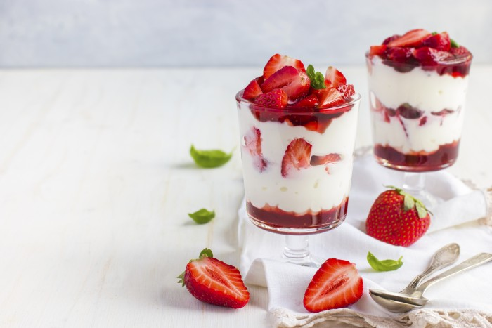 dessert with fresh strawberry,  cream cheese and strawberry  jam on glasses