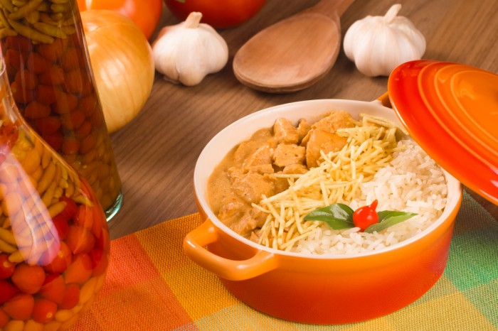 Stroganoff Chicken with rice over a wooden table